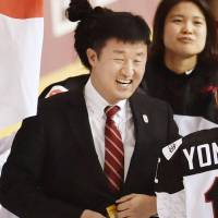 Japan women's ice hockey head coach Takeshi Yamanaka leads the team into the upcoming Asian Winter Games. | KYODO