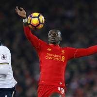 Mane's double brings joy back to Anfield