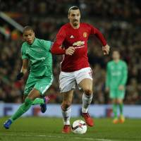 Ibrahimovic nets hat trick as Man United rolls