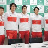 Japan's Davis Cup team poses for photos during a news conference on Wednesday.   KYODO
