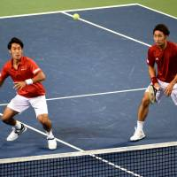 France clinches Davis Cup tie with Japan in doubles