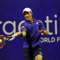 Kei Nishikori plays a shot during his second-round win over Argentina's Diego Schwartzman at the Argentina Open in Buenos Aires on Wednesday. | AP