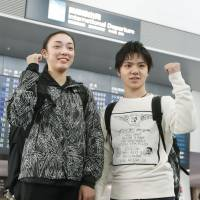 Shoma Uno (right) and Rika Hongo pose for photos at Chubu Centrair International Airport in Nagoya on Monday before leaving for South Korea. | KYODO