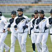 Members of the Japan national team run during the first day of training camp on Thursday in Miyazaki. | KYODO