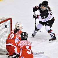 Japan's Ami Nakamura scores a first-period goal against Hong Kong during the Asian Winter Games women's ice hockey tournament on Tuesday night in Sapporo. Japan defeated Hong Kong 46-0. | KYODO