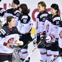Ami Nakamura (23) is honored as the game's best player on Saturday as her Smile Japan teammates enjoy the mood after a win over France.   KYODO