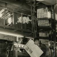 A printing section worker checks a copy of The Japan Times in a photo dated May 3, 1966.