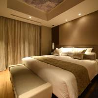 Guests can refresh themselves in a sedately decorated bedroom. | SATOKO KAWASAKI