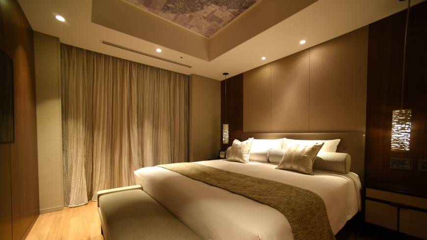 Guests can refresh themselves in a sedately decorated bedroom.