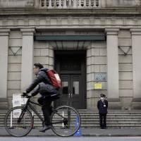 When the Bank of Japan finally hits its inflation target and exits stimulus, it is likely to see huge balance sheet losses. | BLOOMBERG