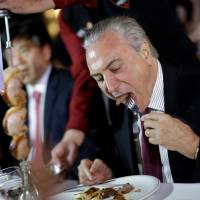 Brazil president tries to minimize fallout from tainted meat trade