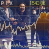 U.S. President Donald Trump's health care setback heightened concerns about his stimulus agenda, sending the yen surging and the Topix down. | AFP-JIJI