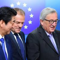 Japan PM, in Brussels, pushes EU trade deal