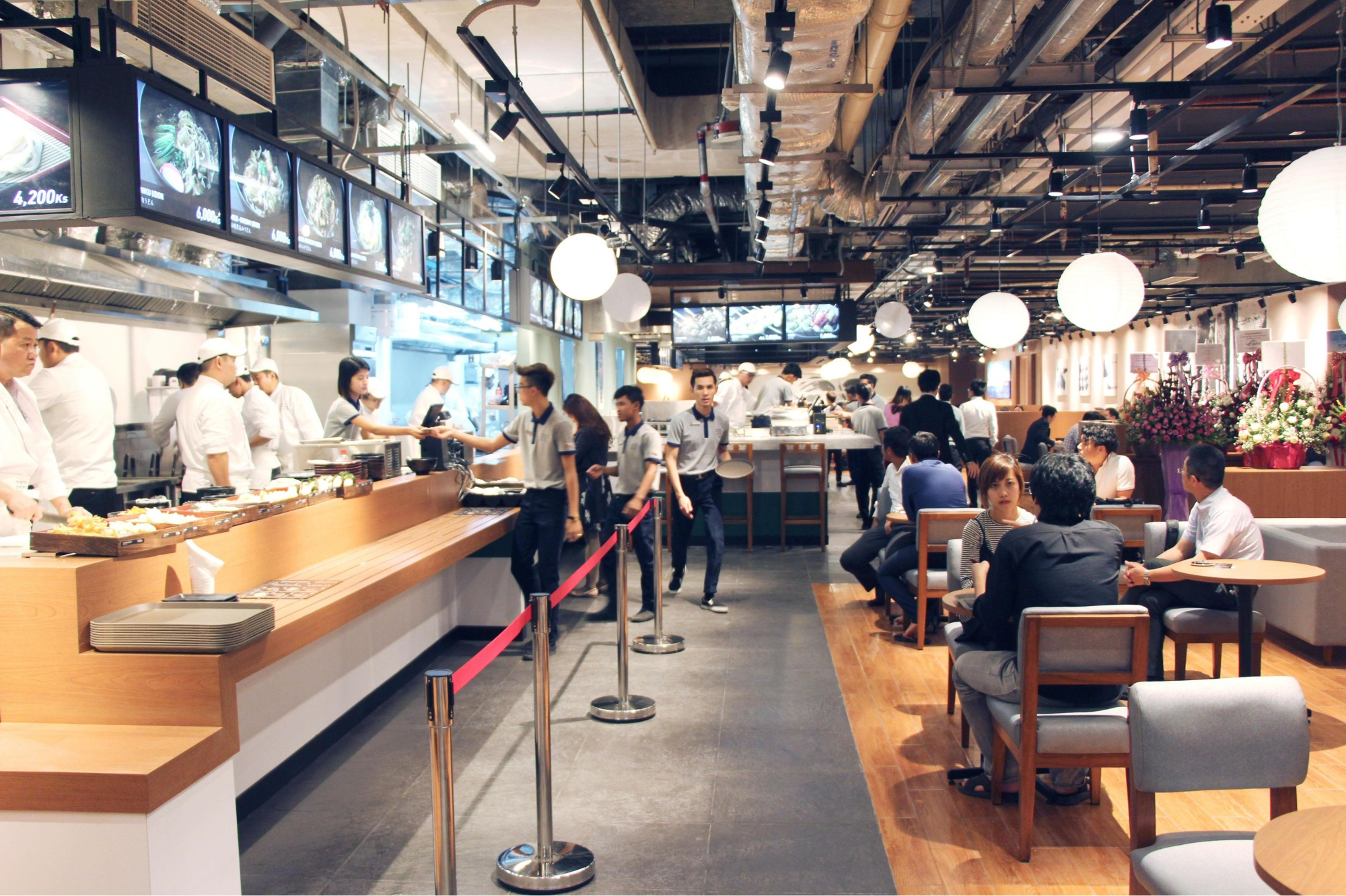 Diners order food at Tokyo Dining City, the first Japanese food court in Myanmar, on Wednesday. The facility in Yangon boasts six restaurants. | KYODO