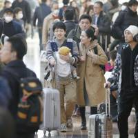 Travelers jam the departure lobby at Tokyo's Haneda airport. The capital's aviation hub saw a record 80.1 million passengers last year, buoyed by a rise in the number of foreign tourists. | KYODO