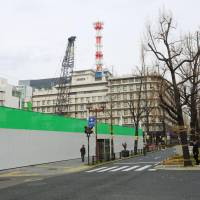 A construction site is seen in Osaka in the city's Midosuji district in December. Numerous hotels have been constructed in the area recently. | KYODO