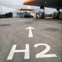 An H2 sign directs vehicles toward Royal Dutch Shell PLC's hydrogen refueling pumps at their first U.K. hydrogen fuel station in Cobham. | BLOOMBERG