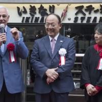 Ikinari Steak founder Kunio Ichinose listens as former New York Mets manager and player Bobby Valentine speaks during a ceremony marking the chain's opening in the United States on Feb. 23 in New York City. | AP