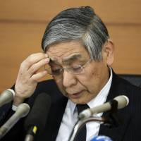 Bank of Japan Gov. Haruhiko Kuroda pauses during a news conference at the central bank's headquarters in Tokyo on Jan. 31. | BLOOMBERG