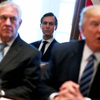 White House advisers Jared Kushner (center) and Steve Bannon (far left) listen as President Donald Trump, flanked by Secretary of State Rex Tillerson, holds a Cabinet meeting at the White House in Washington on Monday.   REUTERS