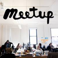 Staff of Meetup are at work in the company's New York office March 13. Meetup.com is taking a leap into the Trump resistance. It's a risky move for the company, whose millions of U.S. members include many Trump supporters. But the decision reflects an increasing willingness of some major tech firms to take on the Republican president. | AP