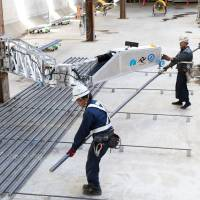 Japan's labor-scarce building sites automating, turning to robots, drones