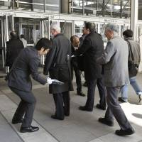 Shareholders of embattled electronics giant Toshiba Corp. enter an emergency meeting in the city of Chiba on Thursday.   KYODO