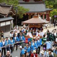 Visitors to this 1,200-year-old Buddhist temple at Mount Koya in Wakayama Prefecture will be able to buy souvenirs and pay entry fees using Square Inc.'s credit card readers from May. | KYODO