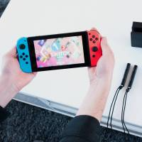 A Nintendo Co. Switch game console is displayed during the company's launch event in New York on March 3. | BLOOMBERG