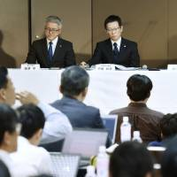 Toshiba Corp. executives appear at a news conference on Tuesday at its hedquarters in Tokyo. KYODO