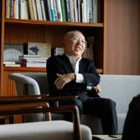 Tadashi Yanai, chairman and chief executive officer of Fast Retailing Co., outlines his company's plans in Tokyo on March 10. | BLOOMBERG