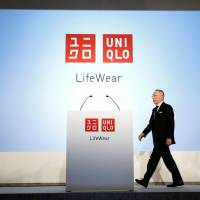 Tadashi Yanai, chairman and chief executive officer of Fast Retailing Co., attends a news conference to mark the unveiling of the company's new headquarters in Tokyo on Thursday. | REUTERS