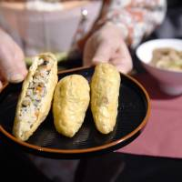 Takeaway art: Fried tofu stuffed with boiled sushi rice is served at the exhibition 'The Mysterious Restaurant of the Food God.' | KYODO