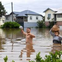 Severe floods overwhelm Australian towns after cyclone