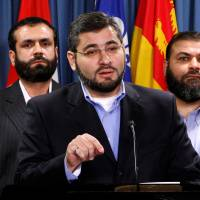 Abdullah Almalki (center), with Muayyed Nureddin (left) and Ahmad El Maati, speaks during a news conference on Parliament Hill in Ottawa in October 2007. | REUTERS