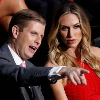 Donald Trump's son Eric Trump and his wife, Lara, attend the third day of the Republican National Convention in Cleveland last July. | REUTERS