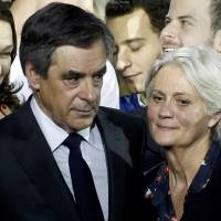 France's Fillon battles to stay in presidential race; wife breaks silence on scandal
