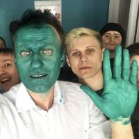 Russian opposition leader Navalny is doused in green liquid