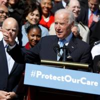 Biden hits Trump camp's 'romance' with Putin, calls GOP health plan cash transfer to super-wealthy