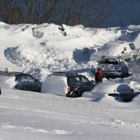 New England digging out, hitting the slopes after crippling blizzard