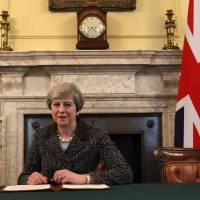U.K.'s May signs letter triggering British exit from EU
