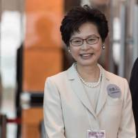 Hong Kong chief executive candidate Carrie Lam smiles during the election on Sunday. | AFP-JIJI