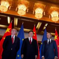 European Commission President Jean-Claude Juncker (left), Chinese President Xi Jinping and European Council President Donald Tusk pose before a meeting at the Diaoyutai State Guesthouse in Beijing in July. | REUTERS