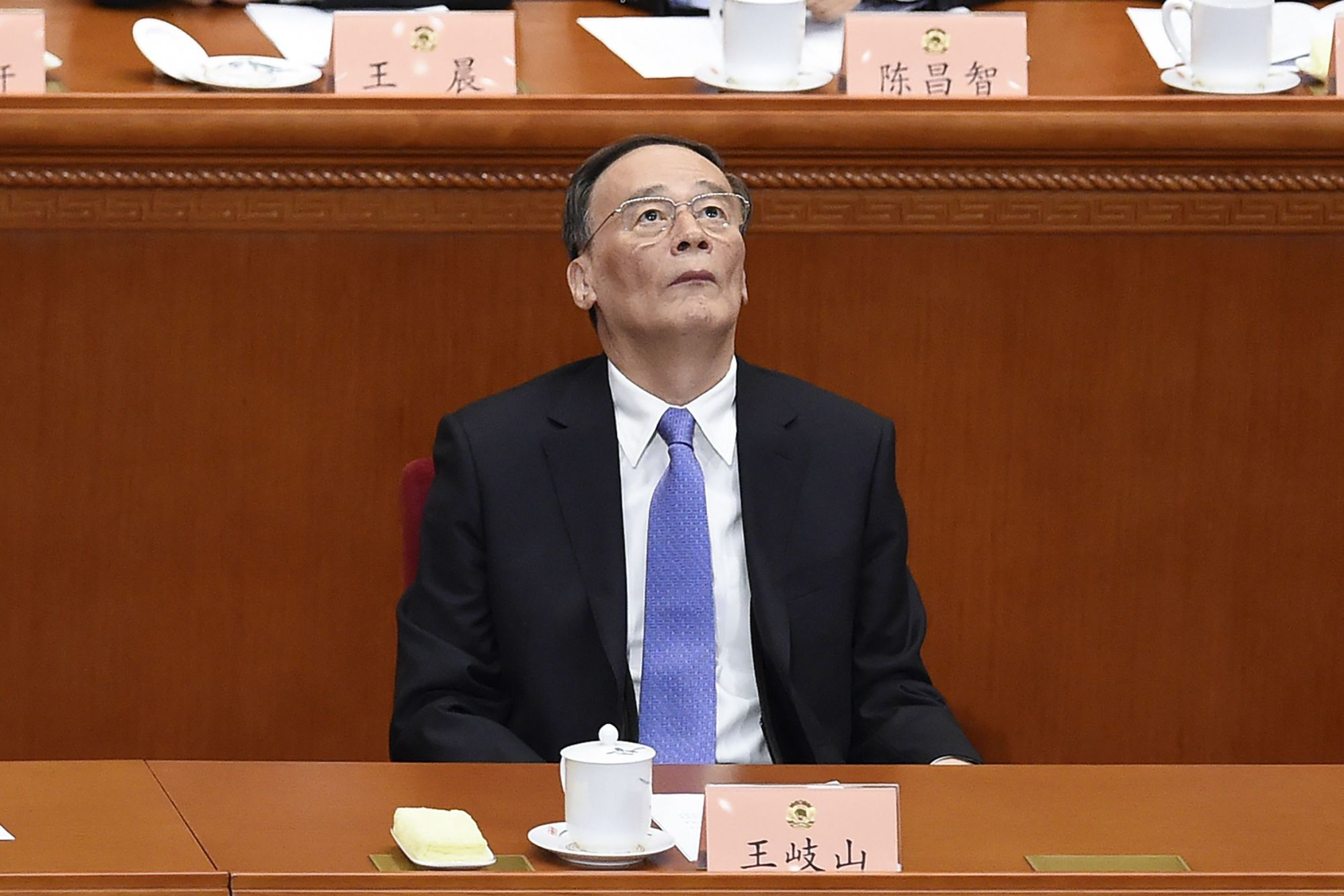 Wang Qishan, a member of the Standing Committee of the Political Bureau of the Communist Party of China Central Committee and secretary of the CPC Central Commission for Discipline Inspection, attends the opening session of the Chinese People's Political Consultative Conference at the Great Hall of the People in Beijing on Friday.   AFP-JIJI
