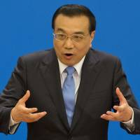 Chinese premier calls for return to talks with North Korea, touts progress on South China Sea row
