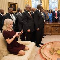 Trump aide Conway says meant no harm kneeling on White House sofa