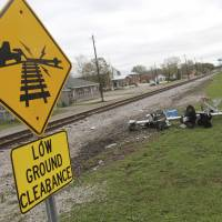 Steep Mississippi grade crossing's history of accidents scrutinized after deadly train-bus crash