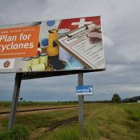 A cyclone warning sign is seen outside the city of Townsville in far north Queensland on Monday. | AFP-JIJI