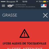 A French police  alert is displayed cell phone in Paris, France, on Thursday. The French government sent out an alert warning of an attack at the Alexis de Tocqueville high school in the southern French town of Grasse.   AP