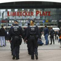 Germany hunts possible Islamic State contacts of mall attack plotter